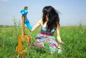 Portrait of hippie posing outdoor with guitar — Foto de Stock