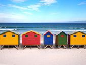 Row of wooden brightly colored huts — Stok fotoğraf