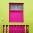 Wall. Door to balcony. Bright colors. Deep pink and yellow-green — Stock Photo #46701233