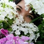 Постер, плакат: Girl with green eyes in flowers