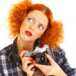 Redhead gilr with old SLR camera — Stockfoto