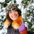 Happy girl and branches covered by snow — Stock Photo