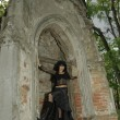 Stock Photo: Goth girl near crypt