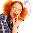 Redhead girl smoking a cigare — Stock Photo #37115057