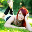 Girl lying on the green grass — ストック写真