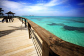 Caribbean beach and wooden pier — Stock Photo