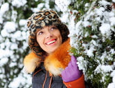 Happy girl and branches covered by snow — Foto Stock