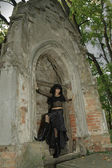 Goth girl near crypt — Stock Photo