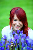 Redhead girl with flowers — Stock Photo