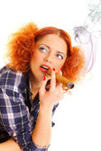 Redhead girl smoking a cigare — Stock Photo