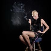 Smoking blond girl — Stock Photo