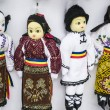 Four dolls portraying a male and three females — Stock Photo