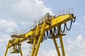 Yellow industrial crane — Stock Photo