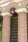 Columns with flowers — Stock Photo