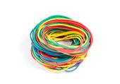 Lots of rubber bands of red, blue, yellow and green colors.  — Stock Photo