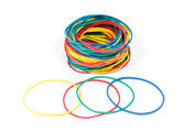 Lots of rubber bands of red, blue, yellow and green colors.  — 图库照片