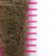 Hair on a pink comb. — Stock Photo