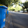 A recycling bin by the side of the road. — Stock Photo