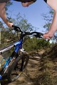 Riding a mountain bike — Stock Photo