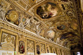 Painting on a ceiling at the Louvre Museum in Paris — Stock Photo