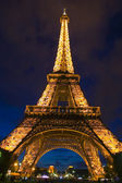 The Eiffel Tower at night Paris France. — Stock Photo
