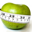 Apple with a measuring tape — Stock Photo #37270415