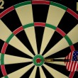 Dart hitting the bulls eye. — Stock Photo