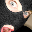 Stock photograph of attractive womwearing balaclava. — Stock Photo #37323817