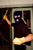 A burglar robbing a house wearing a balaclava. — Stock Photo