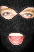 A stock photograph of an attractive woman wearing a balaclava. — Stock Photo