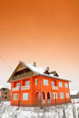 Bright orange house — Stock Photo