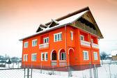 Bright orange house — Stock Photo