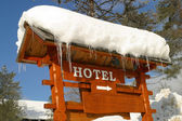 Hotel Sign covered in Ice and Snow — Stock Photo