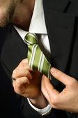 Man correcting tie — Stock Photo
