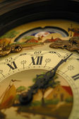 Traditional clock with painting — Stock Photo