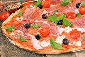 Italian pizza with ham and mozzarella cheese — Photo