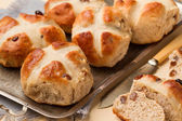 Freshly baked cross buns on a metal tray — Stock Photo