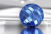 Blue sphere on the mirror surface — Stock Photo