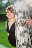 Happy pregnant woman in the summer forest — Stock Photo