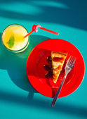 Cheesecake and Lemonade on Blue Table — Stock Photo