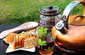 Tea, kettle, teapot, cake — Stock Photo