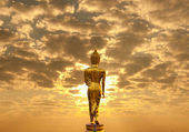 Golden Buddha statue in Wat Phra That Khao Noi, Nan Province, Thailand — Stock Photo