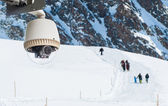 CCTV Camera Operating on snow mountain with people hiking in bac — Stock Photo