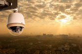 CCTV Camera Operating with city in background — Stock Photo