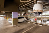 CCTV Camera Operating in car park building — Stock Photo