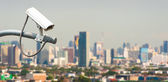 CCTV or surveillance operating with city in background — Stock Photo