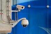 3 CCTV camera or surveillance operating on blue wall bakcground — Stock Photo
