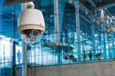 CCTV camera or surveillance operating in air port — Stock Photo