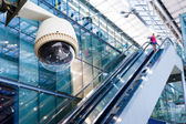 CCTV camera or surveillance operating in glass building — Stock Photo