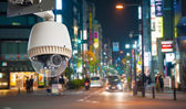 CCTV Camera or surveillance oeprating on street at night — Stock Photo